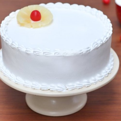 https://media.bakingo.com/sites/default/files/styles/product_image/public/pineapple-round-shaped-cake-5-cake905pine-D.jpg?tr=h-500,w-500