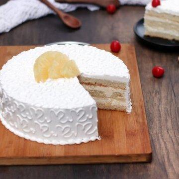 https://media.bakingo.com/sites/default/files/styles/product_image/public/pineapple-vegan-cake-cake924pine-C.jpg?tr=h-360,w-360