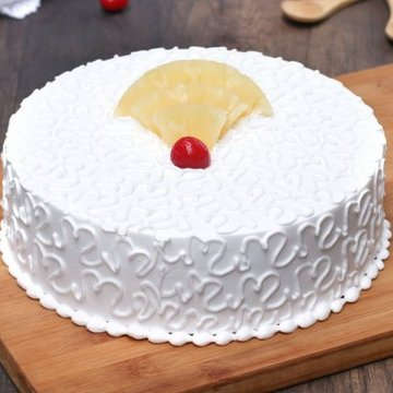 https://media.bakingo.com/sites/default/files/styles/product_image/public/pineapple-vegan-cake-noida-cake1023pine-A.jpg?tr=h-360,w-360