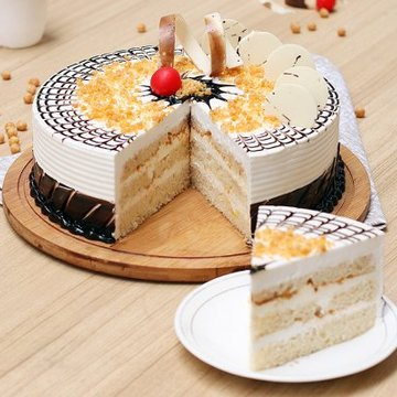 https://media.bakingo.com/sites/default/files/styles/product_image/public/round-shaped-butterscotch-cake-4-cake1478butt-C.jpg?tr=h-360,w-360