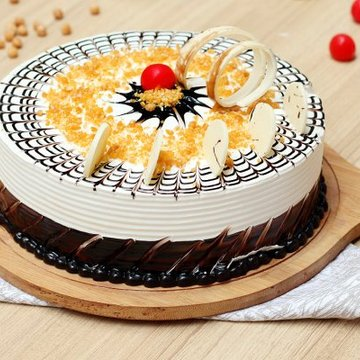 https://media.bakingo.com/sites/default/files/styles/product_image/public/round-shaped-butterscotch-cake-4-ghaziabad-cake1029butt-A.jpg?tr=h-360,w-360