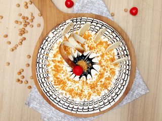 Top View of Round Shaped Butterscotch Cake 4 in Ghaziabad