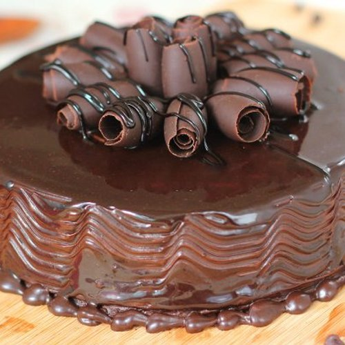 https://media.bakingo.com/sites/default/files/styles/product_image/public/round-shaped-chocolate-cake-1-cake1529choc-C.jpg?tr=h-500,w-500