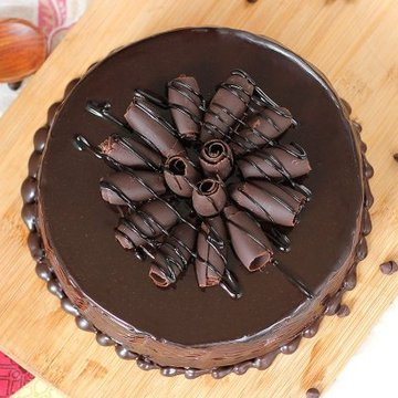 https://media.bakingo.com/sites/default/files/styles/product_image/public/round-shaped-chocolate-cake-1-cake1540choc-B.jpg?tr=h-360,w-360