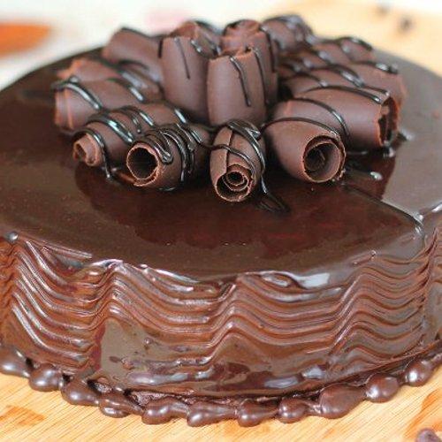 https://media.bakingo.com/sites/default/files/styles/product_image/public/round-shaped-chocolate-cake-1-cake1551choc-C.jpg?tr=h-500,w-500