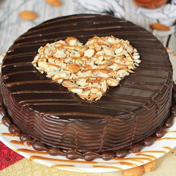 https://media.bakingo.com/sites/default/files/styles/product_image/public/round-shaped-chocolate-nuts-cake-1-cake0651choc-A.jpg?tr=h-360,w-360