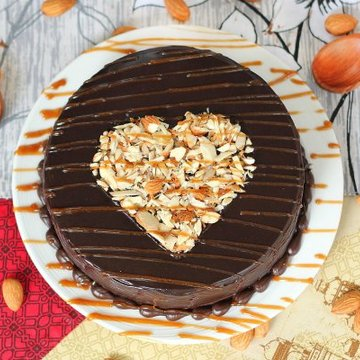 https://media.bakingo.com/sites/default/files/styles/product_image/public/round-shaped-chocolate-nuts-cake-1-cake0651choc-B.jpg?tr=h-360,w-360