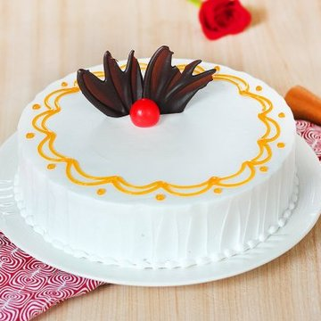 https://media.bakingo.com/sites/default/files/styles/product_image/public/round-shaped-vanilla-cake-1-cake0614vani-A.jpg?tr=h-360,w-360