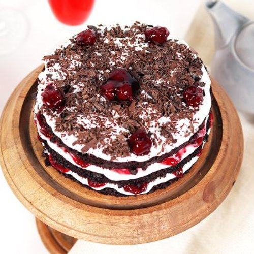 https://media.bakingo.com/sites/default/files/styles/product_image/public/semi-naked-blackforest-cake-cake1640blac-B_0.jpg?tr=h-500,w-500