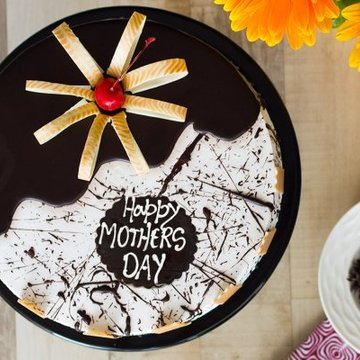 https://media.bakingo.com/sites/default/files/styles/product_image/public/serene-smile-a-mothers-day-special-cake-C.jpg?tr=h-360,w-360