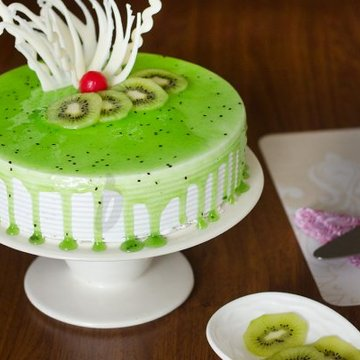 https://media.bakingo.com/sites/default/files/styles/product_image/public/simple-kiwi-cake-A.jpg?tr=h-360,w-360