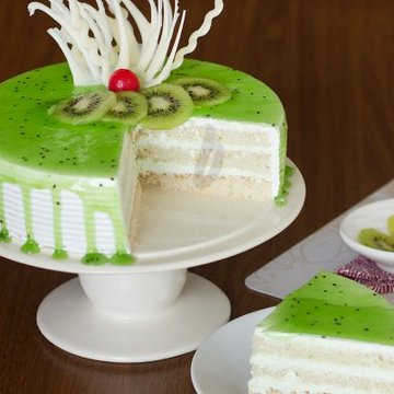 https://media.bakingo.com/sites/default/files/styles/product_image/public/simple-kiwi-cake-B.jpg?tr=h-360,w-360