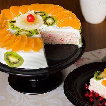 https://media.bakingo.com/sites/default/files/styles/product_image/public/sliced-view-of-fresh-fruit-cake0848flav-b.jpg?tr=h-360,w-360