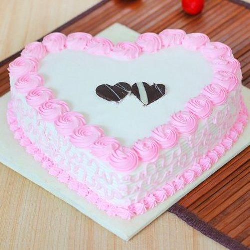 https://media.bakingo.com/sites/default/files/styles/product_image/public/strawberry-heart-shaped-cake-1-cake0643hstr-A.jpg?tr=h-500,w-500