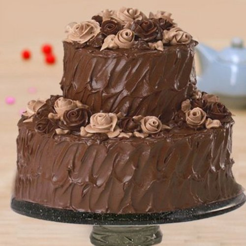 https://media.bakingo.com/sites/default/files/styles/product_image/public/two-tier-chocolate-cake-part1355choc.jpg?tr=h-500,w-500