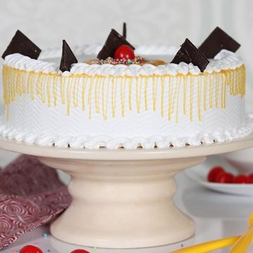 https://media.bakingo.com/sites/default/files/styles/product_image/public/vanilla-cake-with-cherry-cake1609vani-B.jpg?tr=h-360,w-360