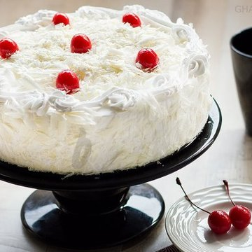 https://media.bakingo.com/sites/default/files/styles/product_image/public/white-forest-cake-in-ghaziabad-cake0828flav-a.jpg?tr=h-360,w-360