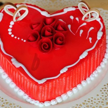 https://media.bakingo.com/sites/default/files/styles/product_image/public/zoom-view-of-heart-shaped-vanilla-strawberry-cake-in-ghaziabad-cake0859flav-c.jpg?tr=h-360,w-360