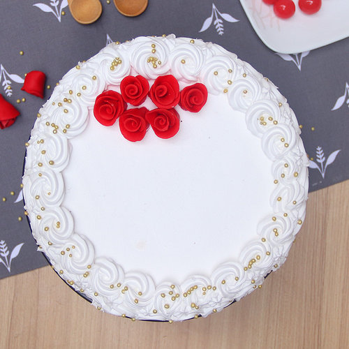 https://media.bakingo.com/sites/default/files/theme-cake-with-roses-them1306flav-C.jpg