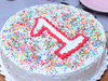 Zoomed View of Vanilla Cake With Toppings For 1st Birthday