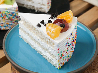 Sliced View of Fruit Funfetti Vanilla Cake  with ingredients