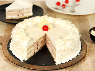 Sliced View of Creamy White Forest Cake