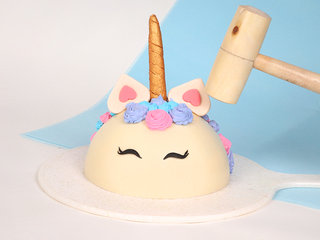 Side View of Unicorn Pinata Cake with Hammer