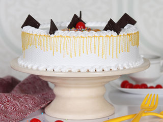Side View of Vanilla Cake With Cherry