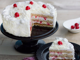 Sliced View of White Paradesia - A White Forest Cake